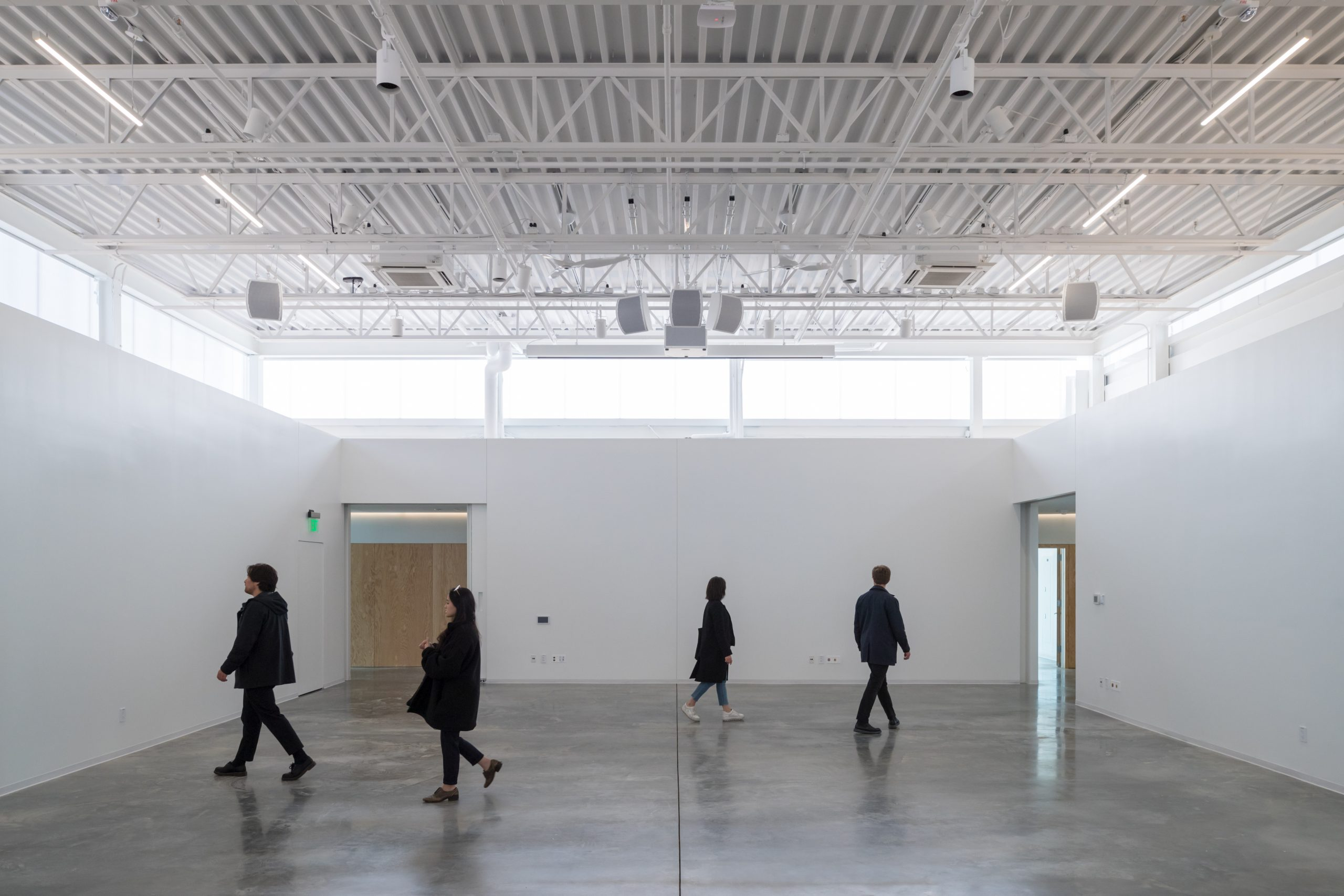 People walking around in an empty studio