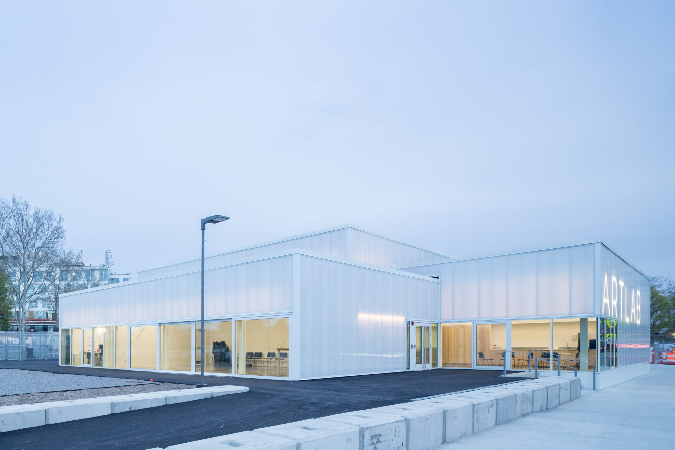 Stacked boxy volumes clad in translucent plastic
