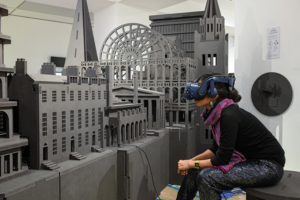 A woman in a VR headset looking at an architectural model