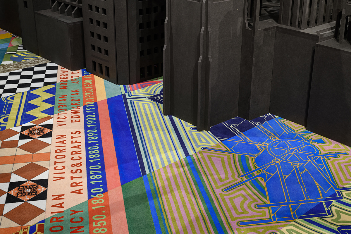 The exhibition's colorful carpet acts as a timeline of different architectural movements. (Francis Ware/RIBA)