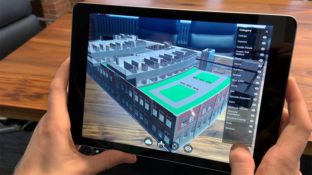 Image of iPad with architectural visualization on it