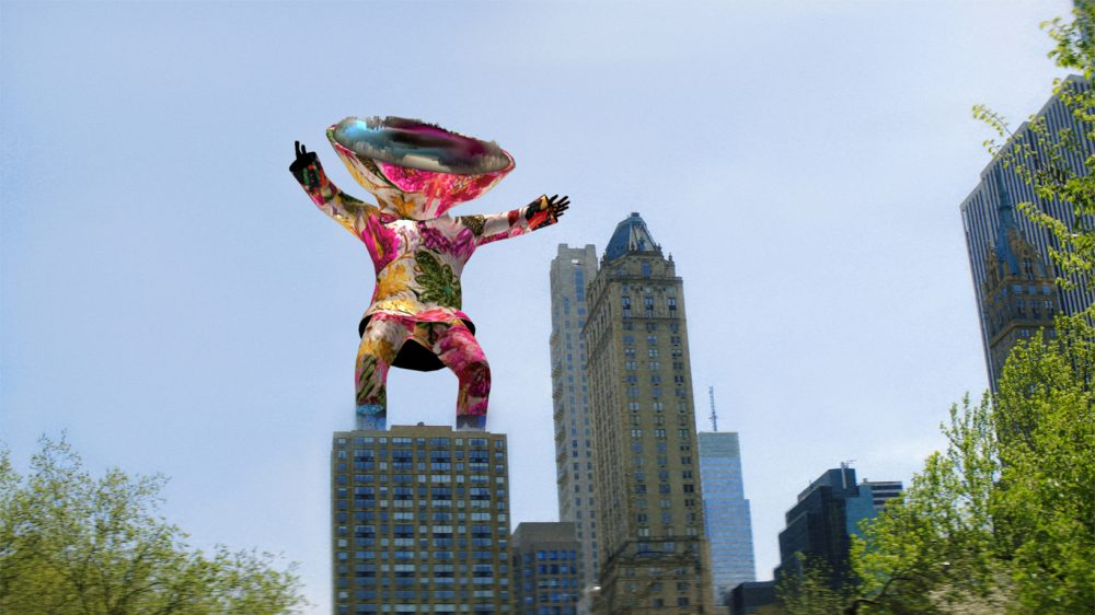 A 3D person in a colorful suit with a large disk for a head stands on top of a high rise.
