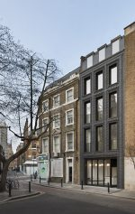 Photo of a gray brick building on a London street.