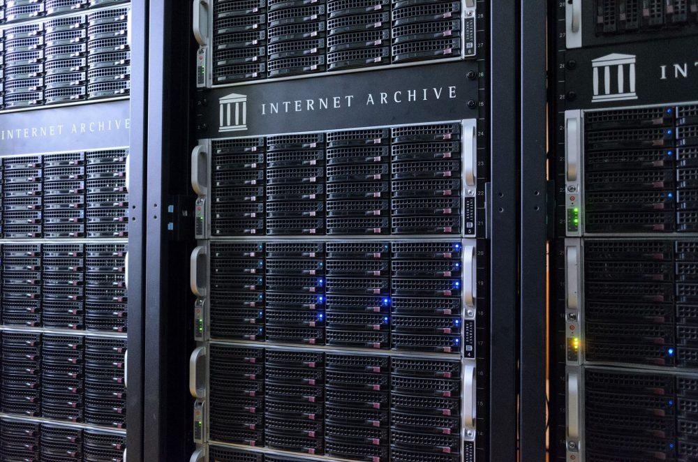 Racks of servers with the Internet Archive logo on them