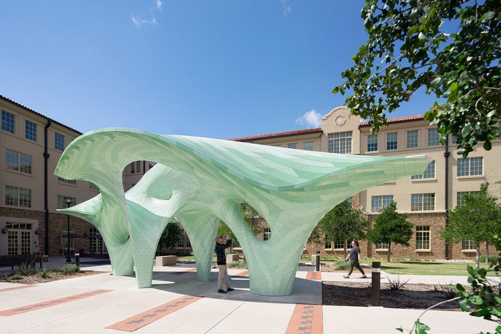 An undulating green pavilion in a public square at a university, designed by Marc Fornes / THEVERYMANY