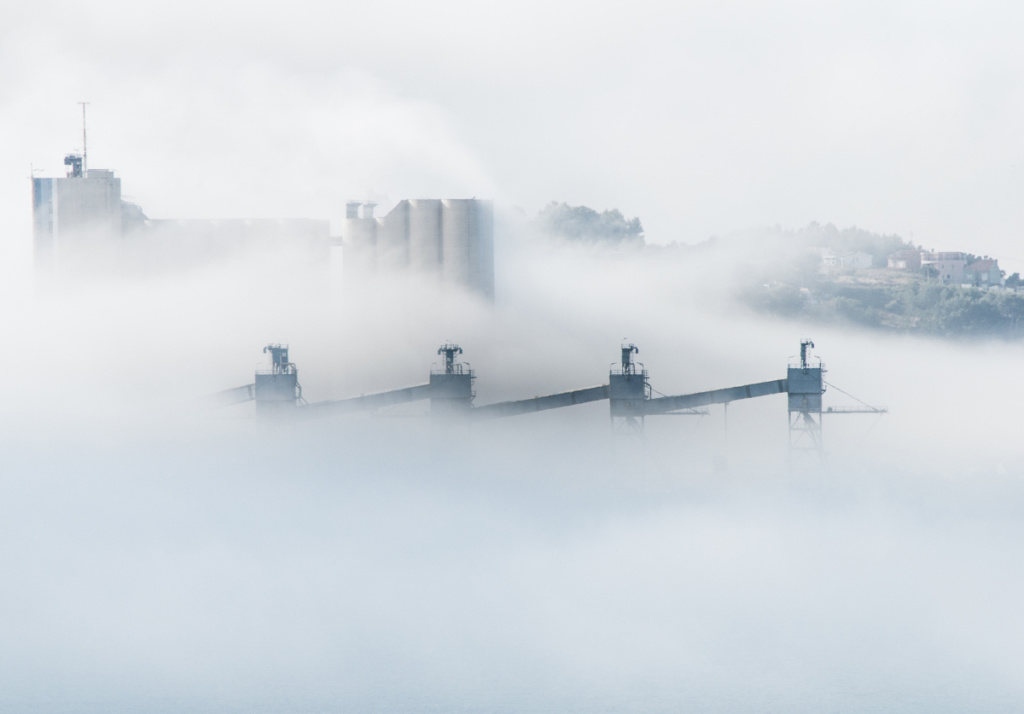 A white smokey cityscape. Skanska is proposing a tool to cut down on embodied carbon emissions.
