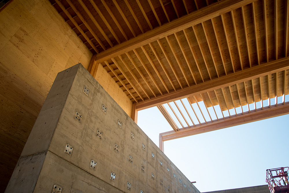 A view of a ceiling and interior wall made out of various lumber products