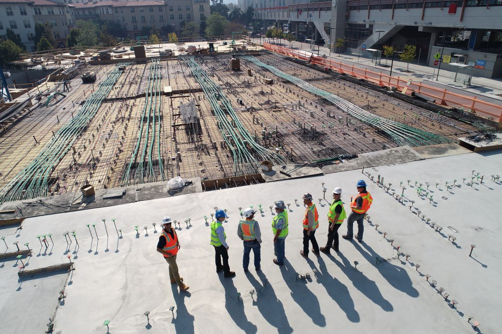 construction workers on a work site, not social distancing