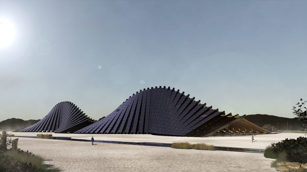 an undulating structure in the middle of the desert